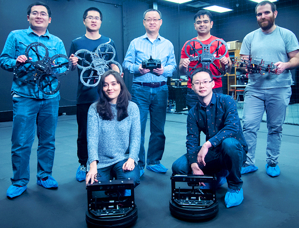 a photo of six people with drone equipment